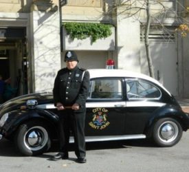 A police officer standing in front of the Saint John Police Museum
